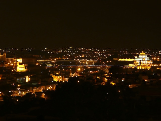 View by night of D. Luiz I bridge and Serra do Pilar from the apartment