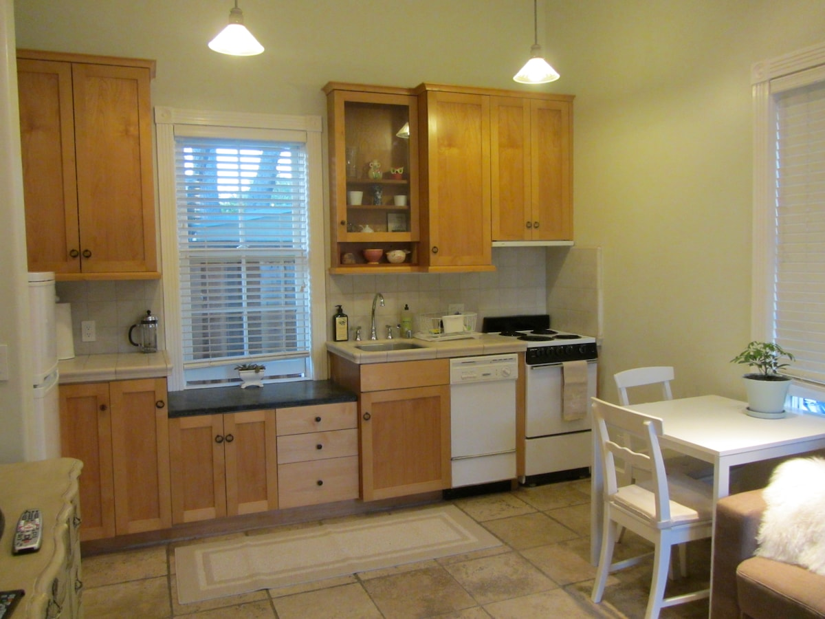 Well stocked kitchen with 4 burner elec stove and oven, microwave, dishwasher