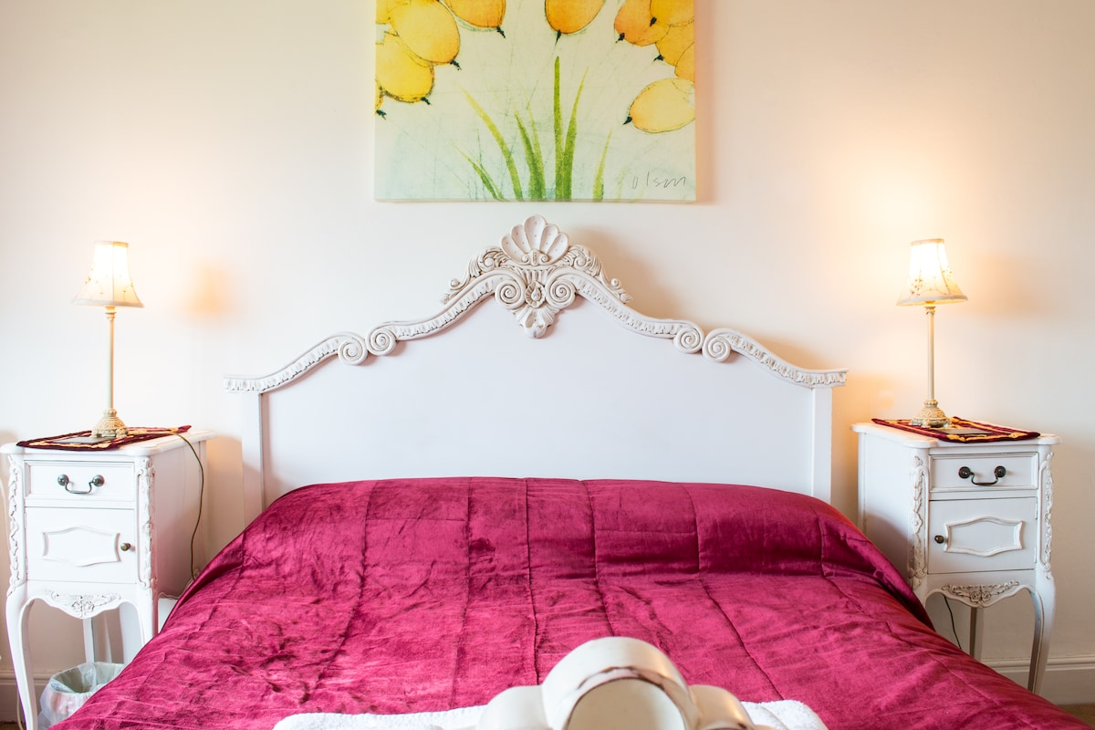 The large 5-foot king size bed in The Fairfield is part of a white-painted mahogany Louis suite.
