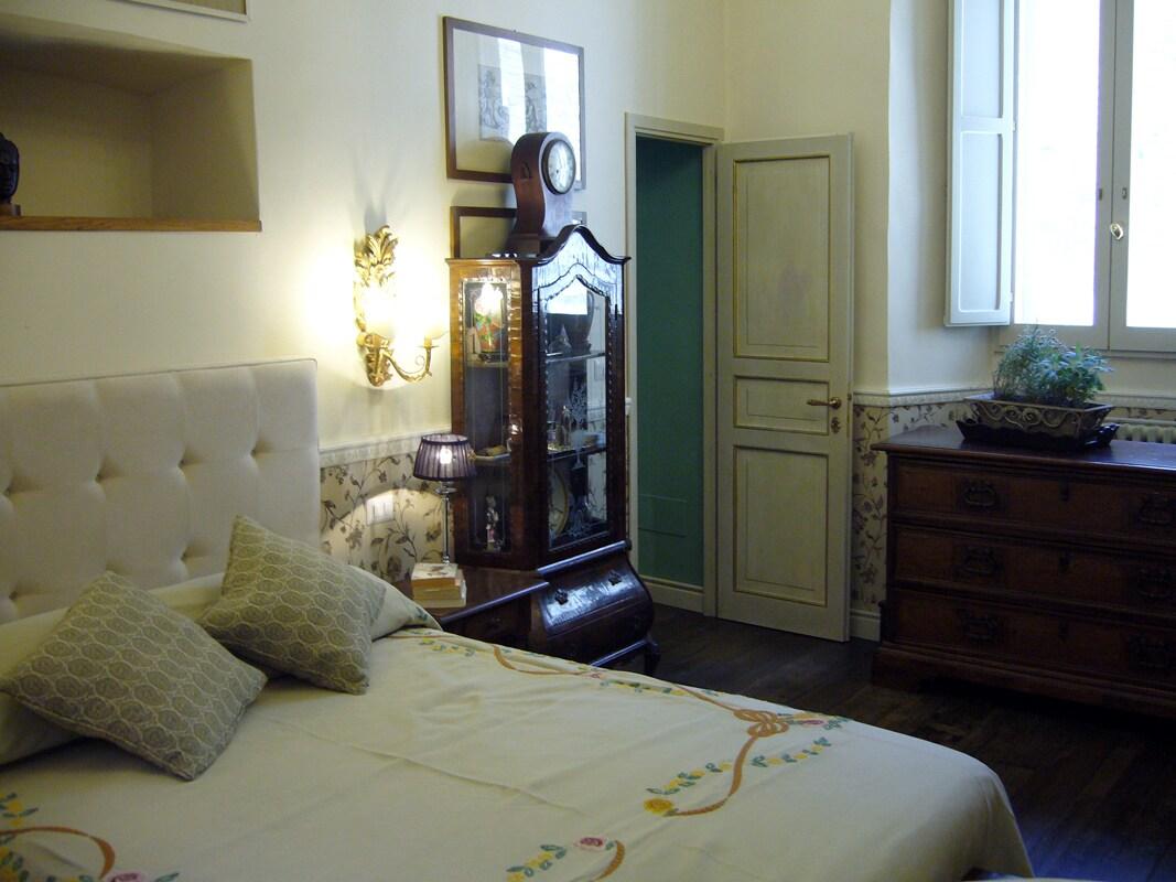 Bedroom connects passageway to twin bedroom