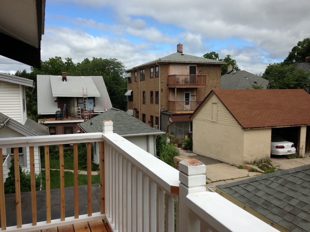 The guest room has a private patio that overlooks the neighborhood.