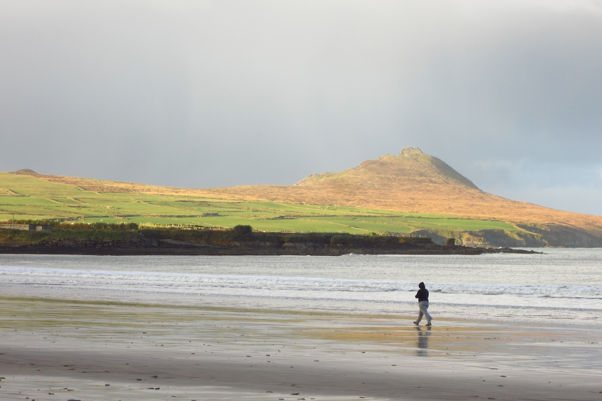 Walk along the beach with the Three Sisters in sight.