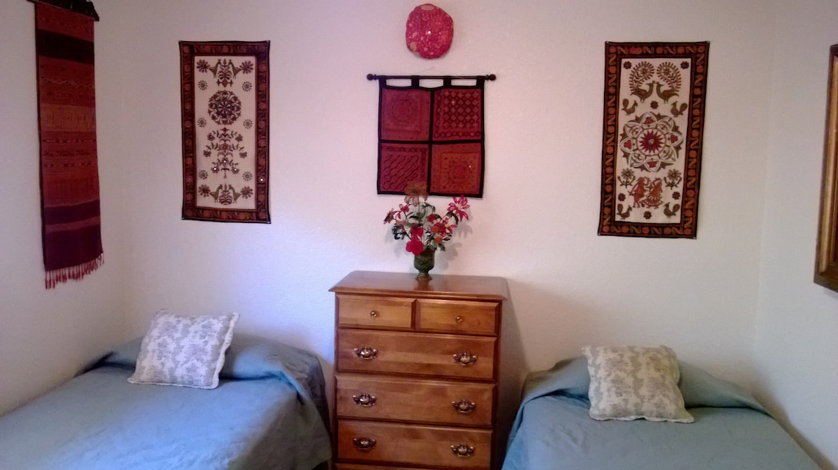 Our twin bed guest room, detached from rest of house by separate apartment door.