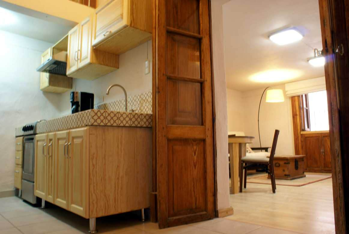 kitchen fully equipped with microwave, coffee machine, toaster, etc