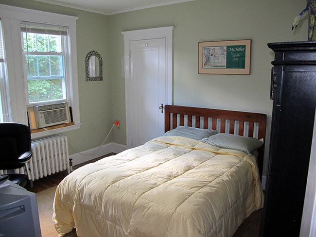 """Your room includes """"full"""" size mattress on a wood-frame bed, tall bureau and AC in summertime."""