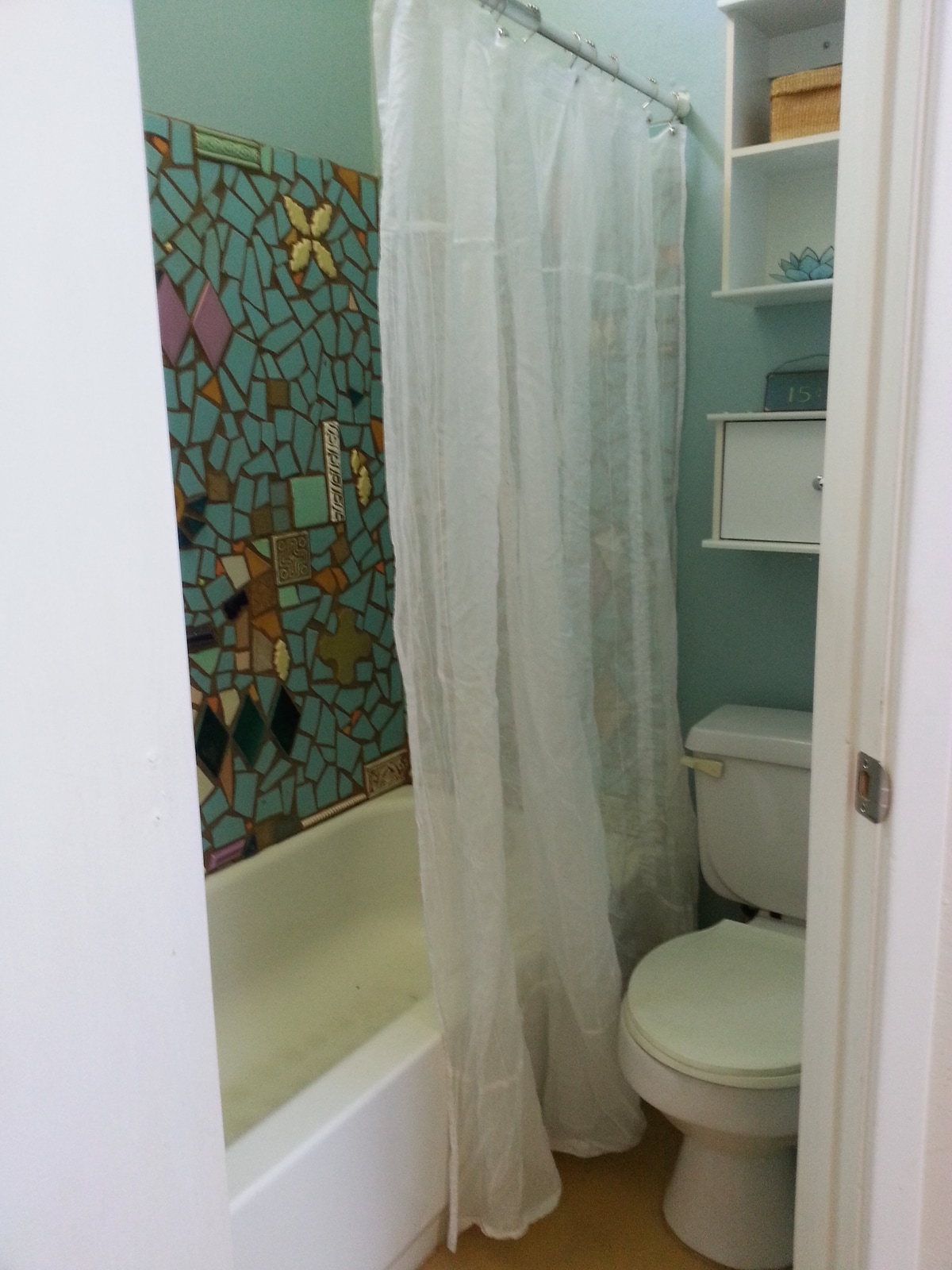 Bathroom with mosaic shower surround