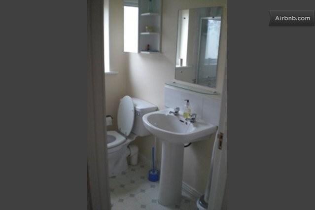 Small bathroom with bath/shower.