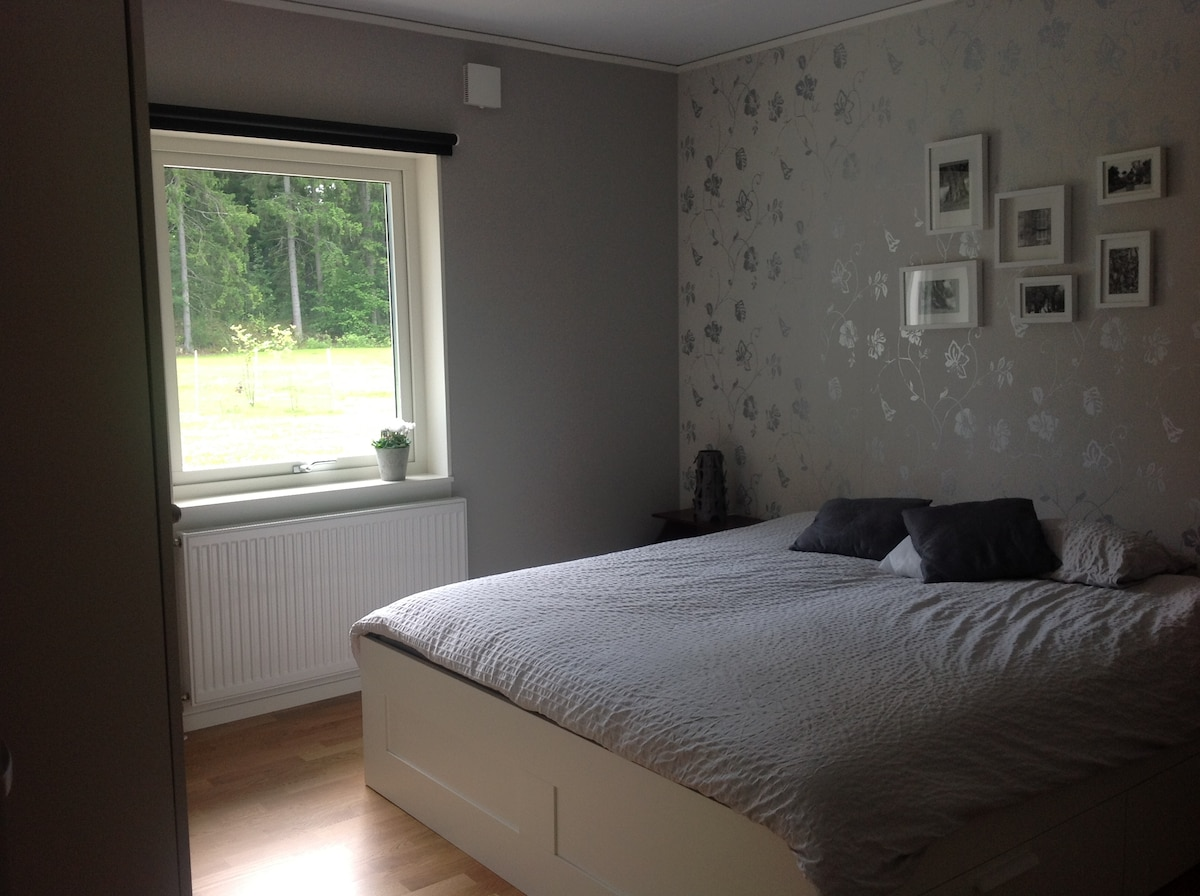 Large bedroom with view on the terrace, with large cupboards