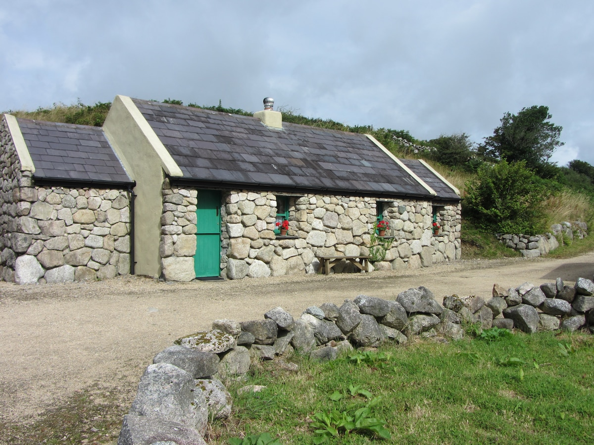 Get away from it all and stay in  'An Nead' - The Nest, Cnoc Suain's one-bedroom cottage set in a restored 17th century Connemara hill-village.