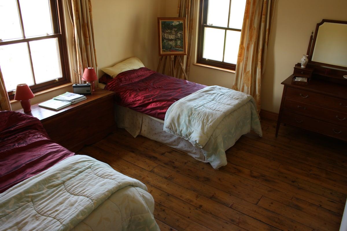 The twin bedroom with view out over the back garden.