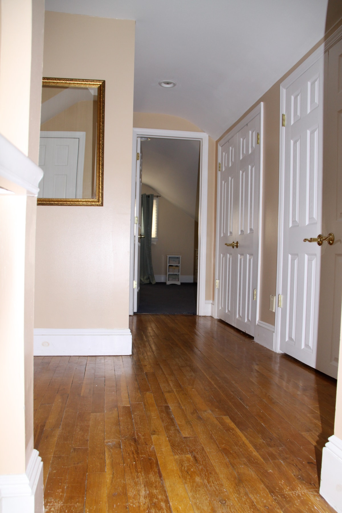 This is the upstairs hallway, with large closets for storage of clothes, shoes, books, suitcases, etc.