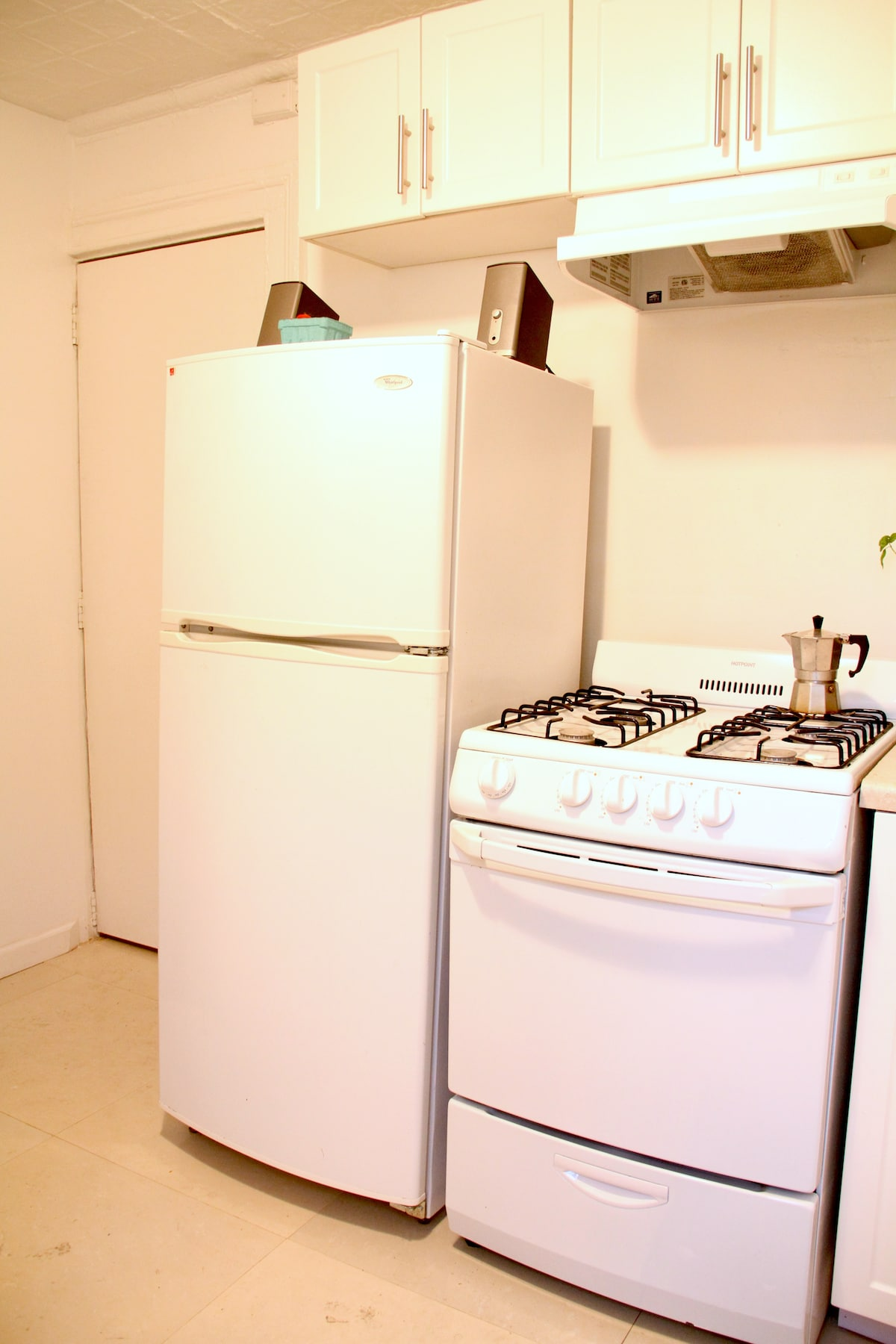 Gas oven and new fridge, the door behind is one of the two entrances