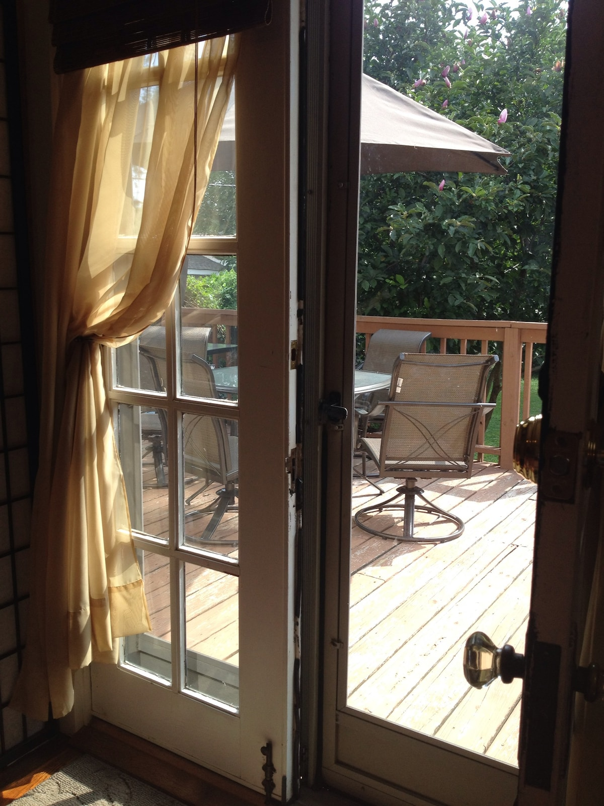 "View out your ""back"" door with private access to the deck overlooking the backyard."