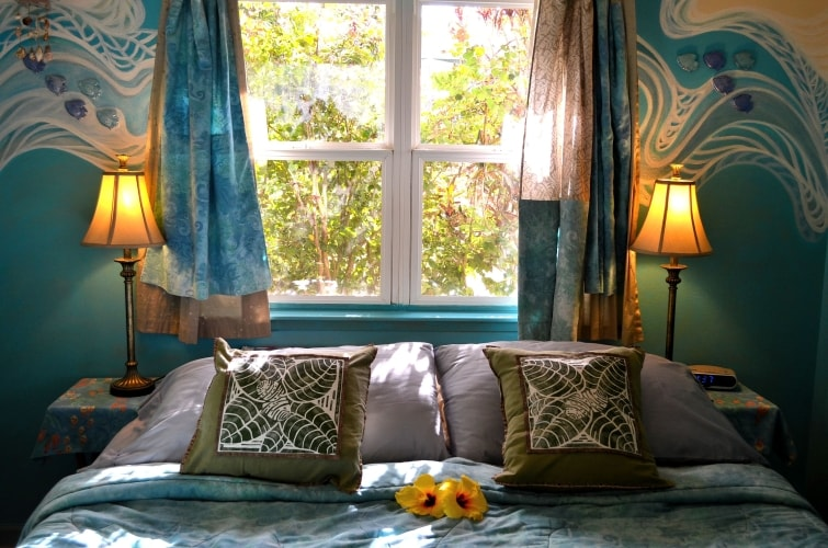 king-size bed in master bedroom at Whispering Bamboo Cottage
