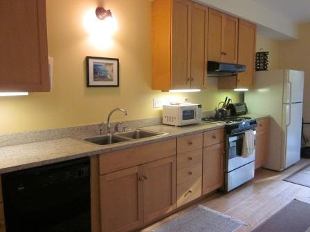 Maple and granite fully equipped kitchen.