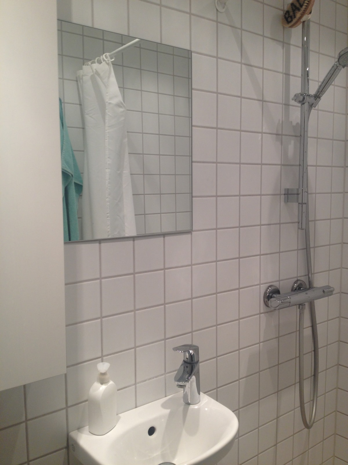 A small bathroom with shower.