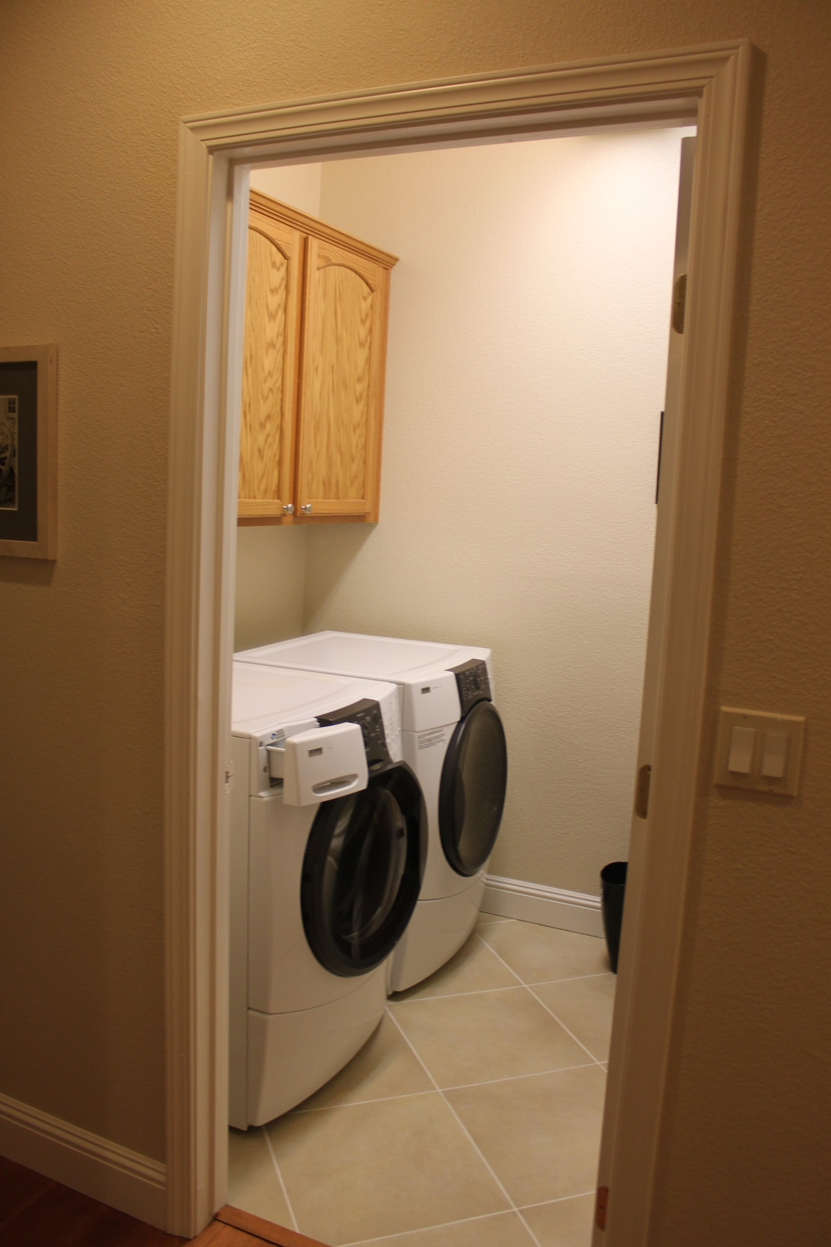 Large laundry room with front load washer & dryer.