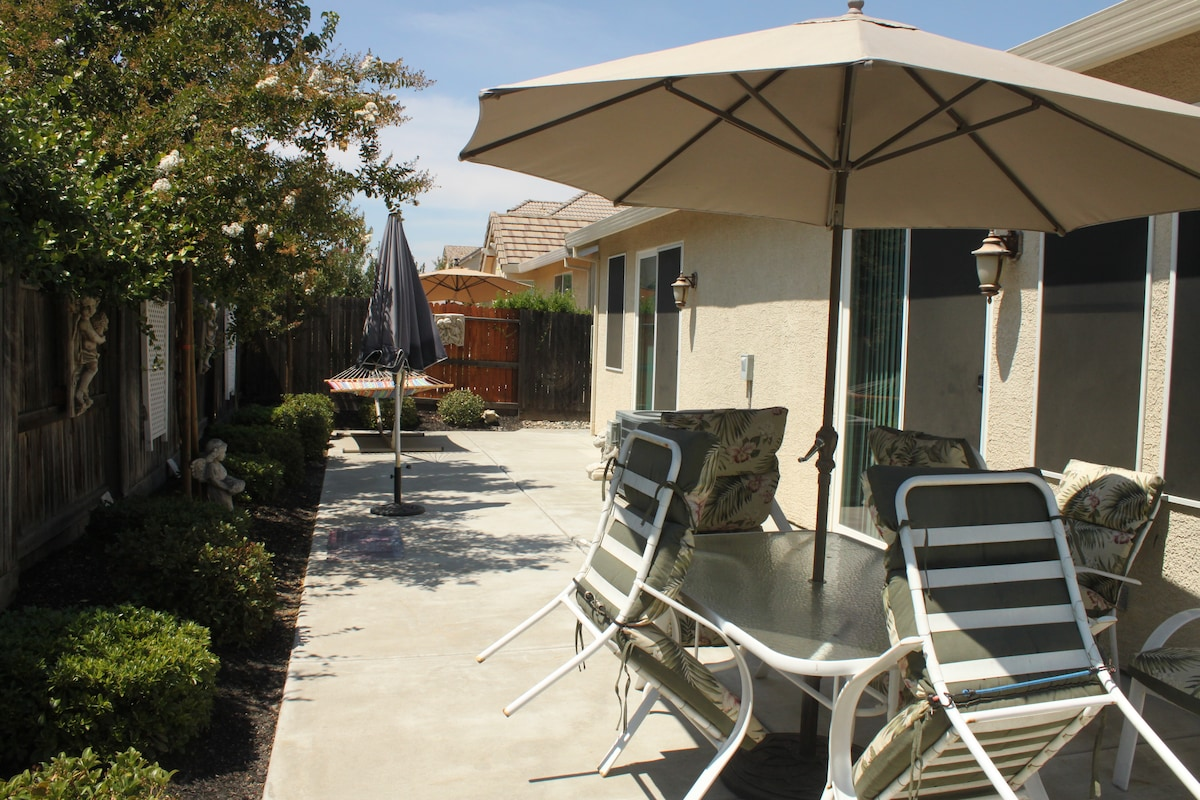 Large rectangle patio with table for six and hammock.