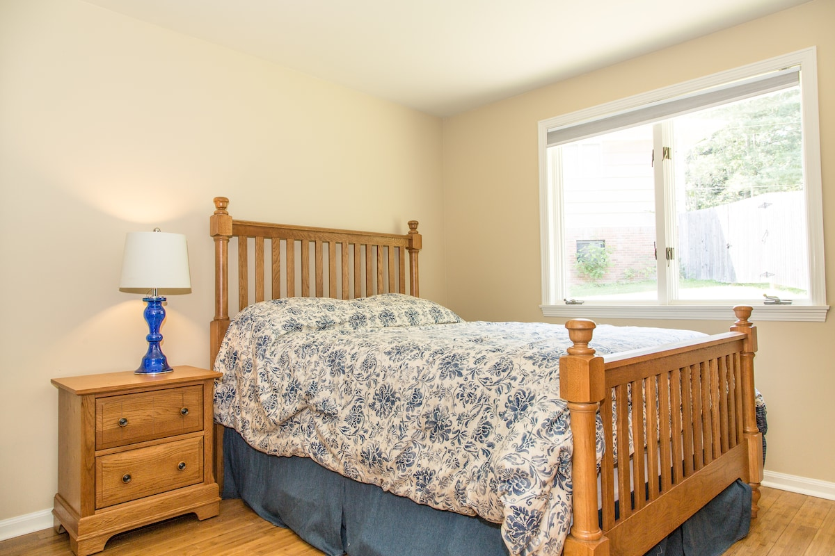 Main Level bedroom with Full Size bed, dresser and desk.