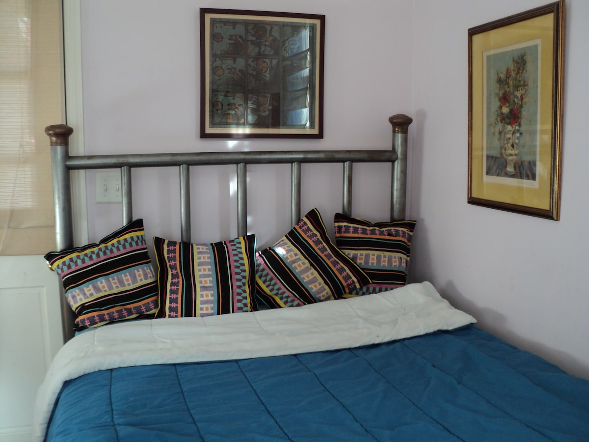 antique bed frame with  double bed mattress