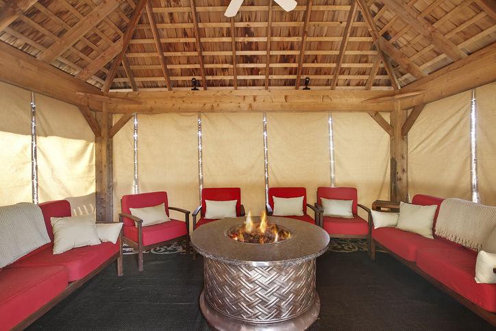 enclosed winter pavilion with firepit