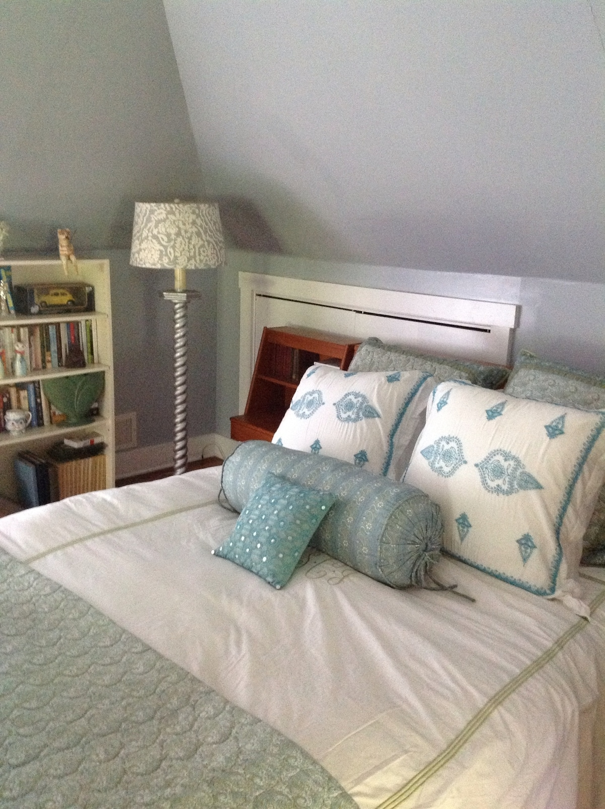 A comfortable queen-sized bed with high quality linens on the 3rd floor