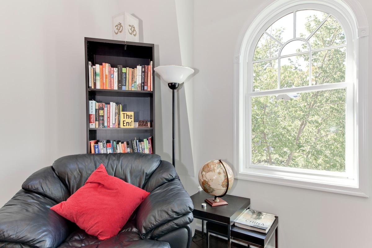 Comfortable couch with lots of interesting development, social commentary and current event books to read.