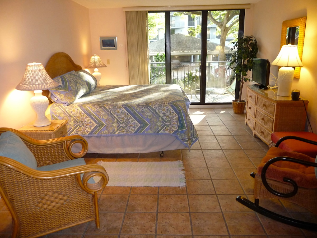 Master bedroom with King bed, and sliding glass door to balcony.