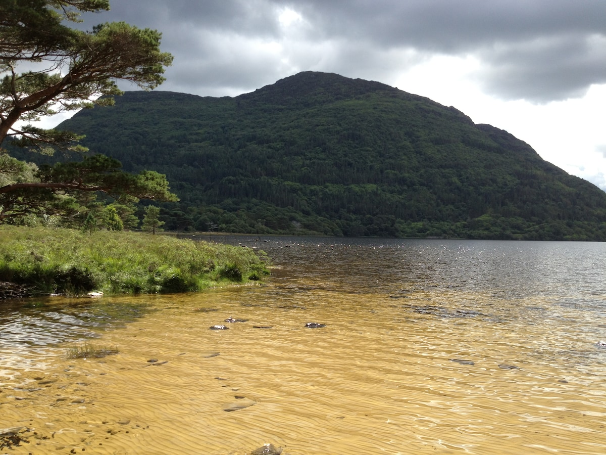 Dundag Beach at Muckross Lake, Muckross House. Torc Mt in background.