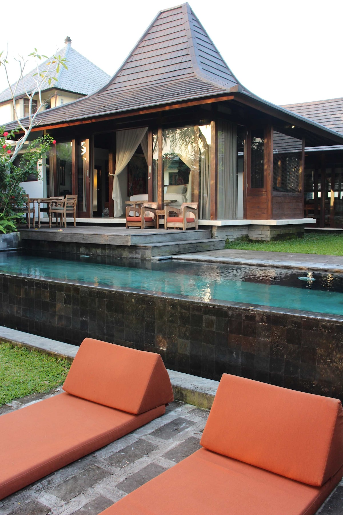 Part of this gorgeous villa is made from a traditional style of Javanese building called a Joglo.