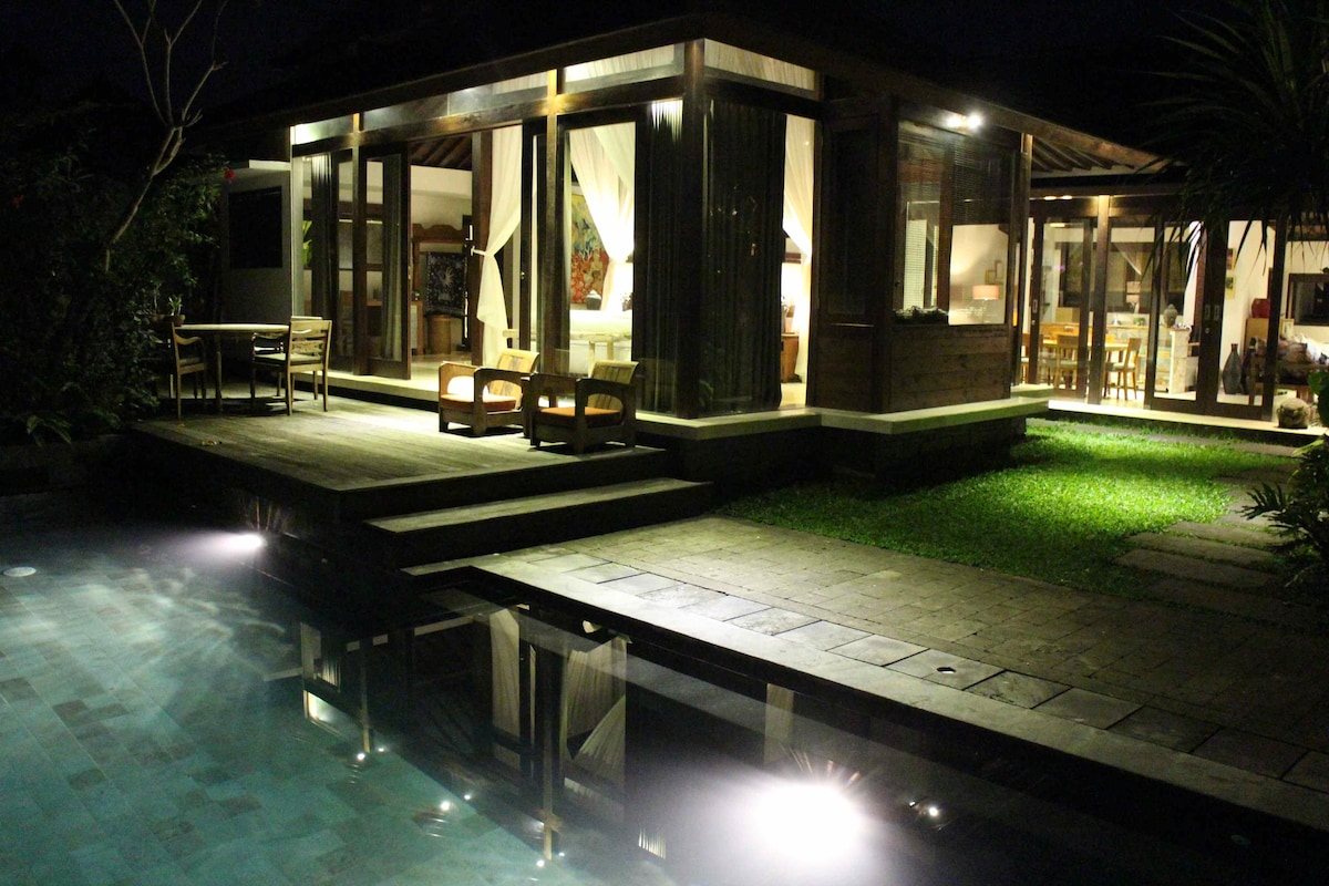 A look at the Joglo Villa and pool with nighttime lighting