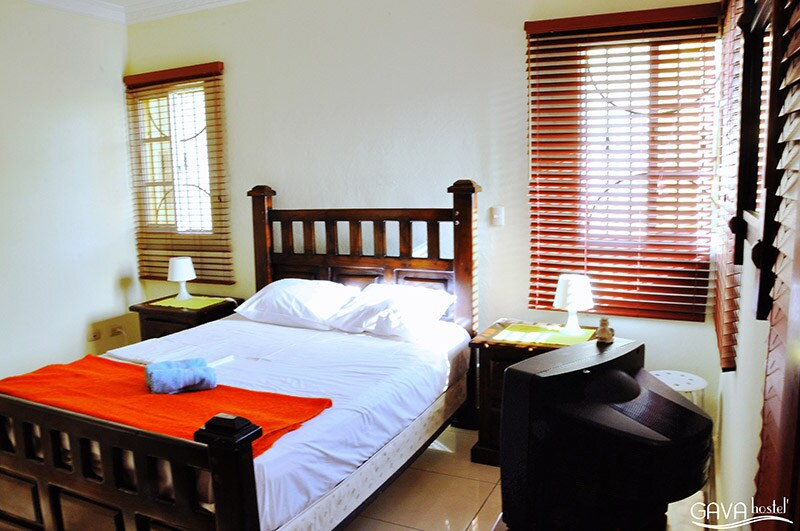 Private double room with en suite bathroom and views of the pool.