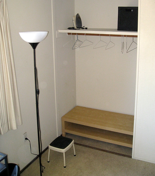 Big closet with open-suitcase table
