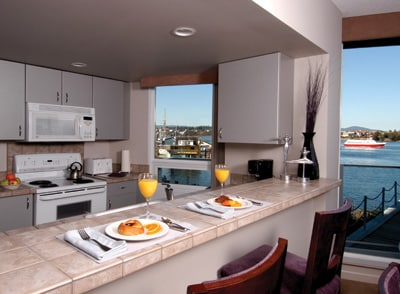 Kitchen and great view of the harbor. This photo is not unit specific, but is indicative of the value and décor of all the units