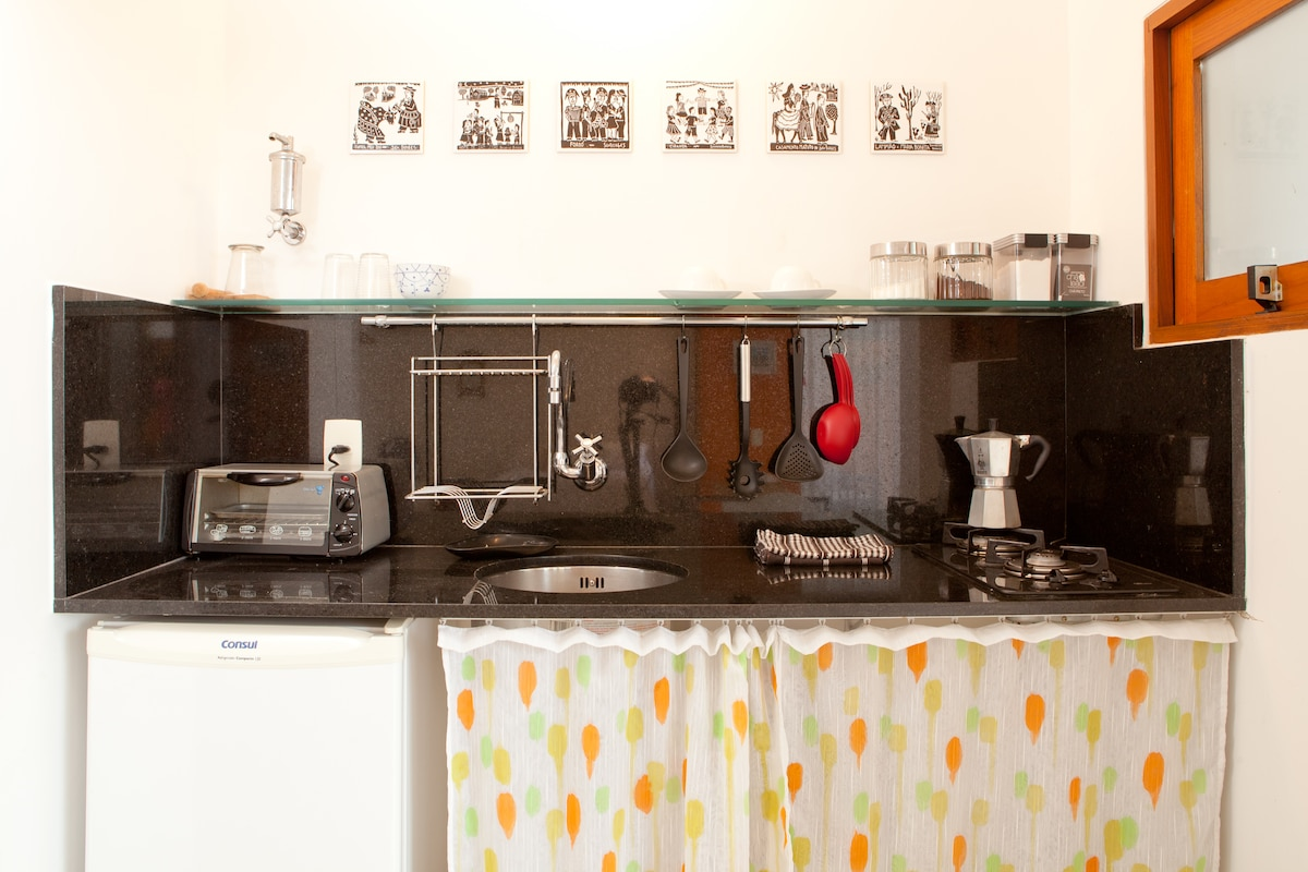 The kitchen has an Italian coffee make,  stove, toaster over, bar fridge and all the basic utensils you will need.