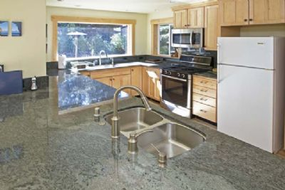 Tons of space for cooking, plus granite counters, stainless steel stove, TWO sinks, and views of patio/yard!