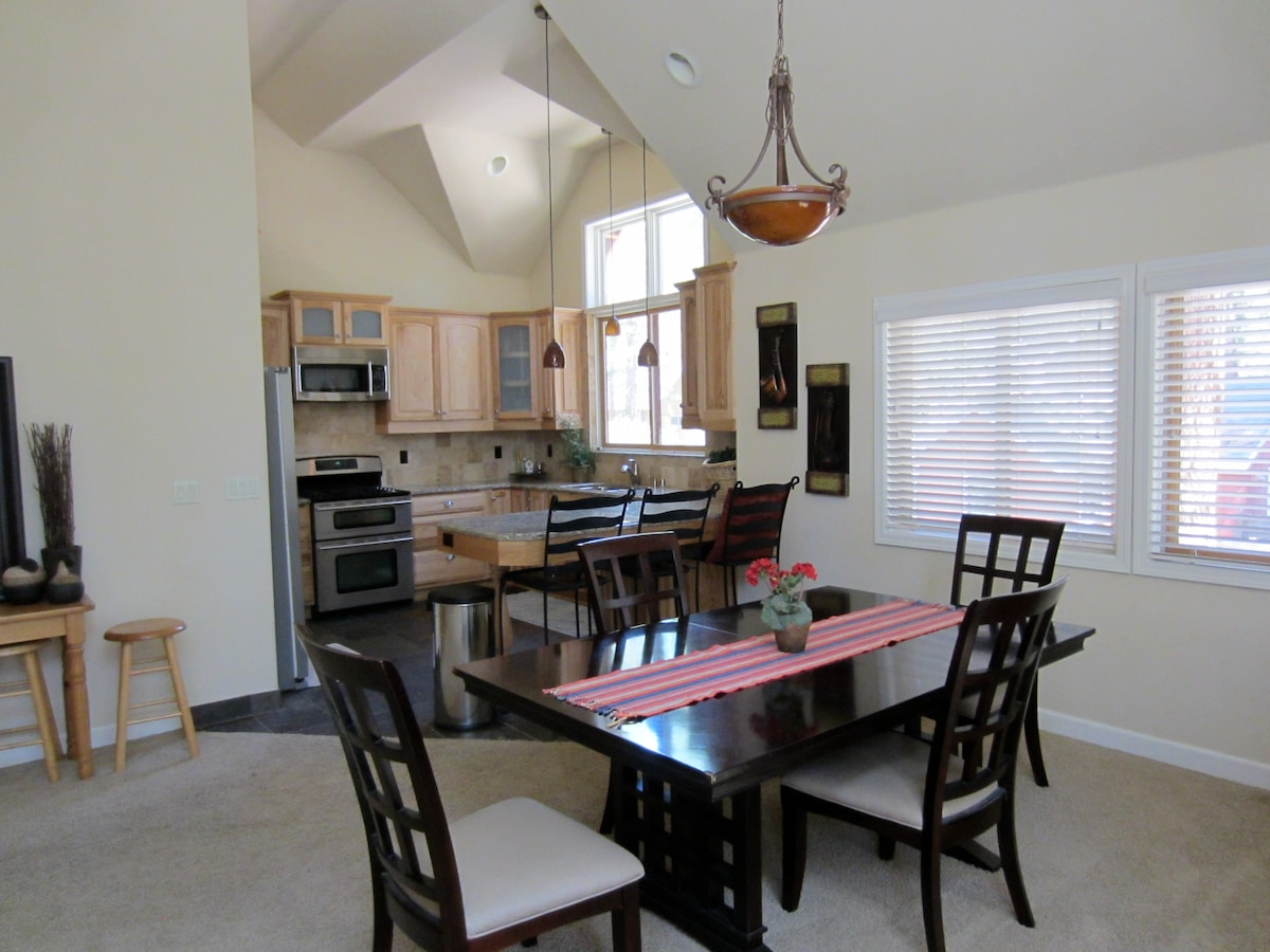 Stainless steel appliances and fully equipped kitchen perfect for cooking.