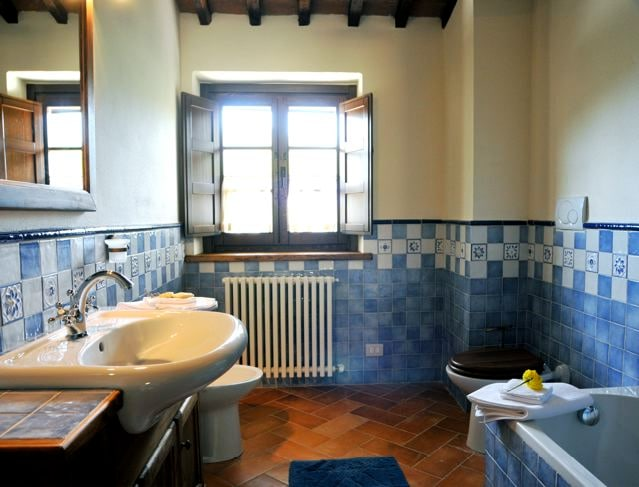 The bathroom is decorated with hand-painted tiles.