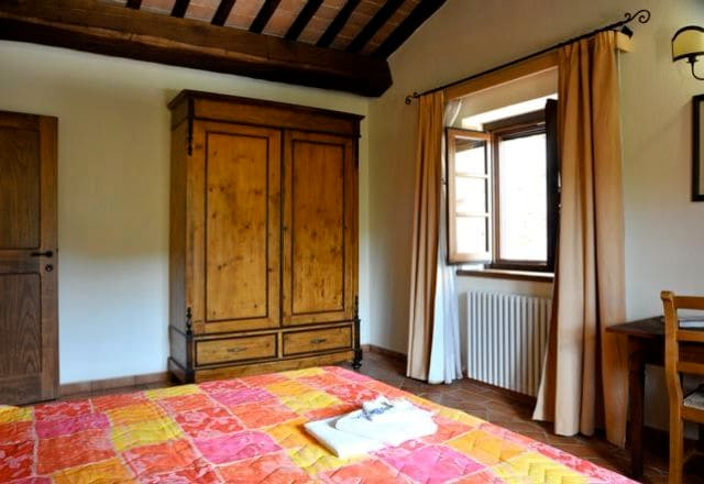 The room is spacious, the furniture is made up of antiques or has been locally hand-made by artisans.