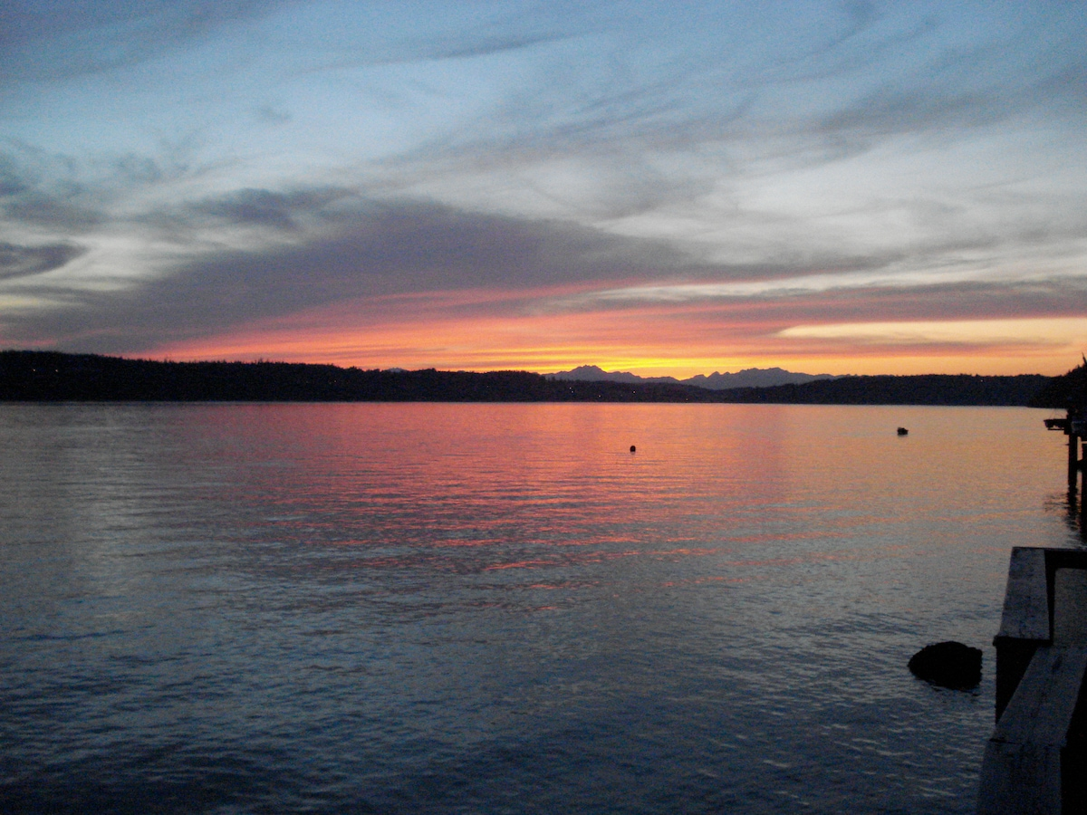 The view from the deck looking to the Olympic Mountains at sunset