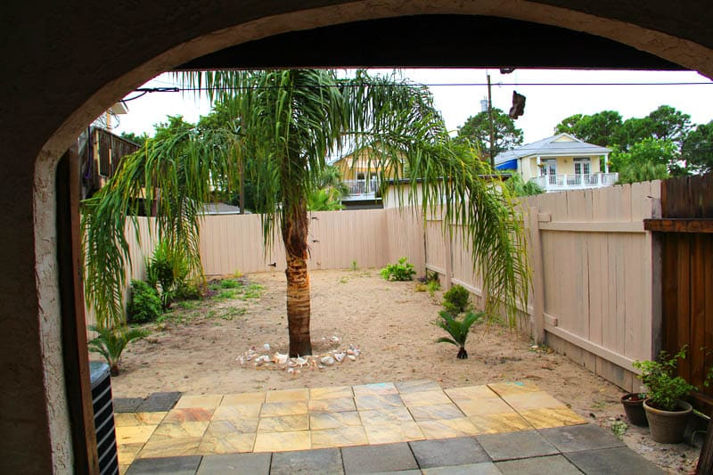 Relax in the private fully fenced backyard with  a grill and a sitting area for you to enjoy a book or a meal, or lounging under a beautiful Argentina Queen Palm Tree.