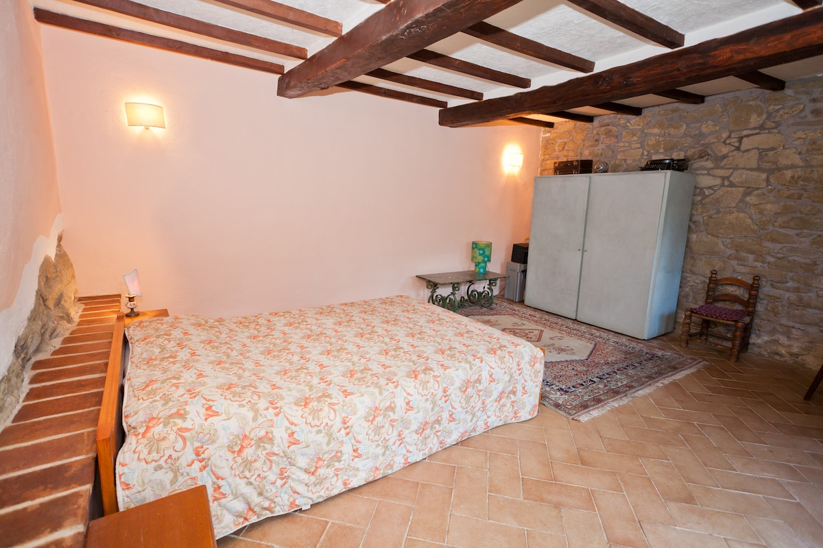 "The bedroom (with the double bed) ""on the rocks""! The naked stone walls are very unique and suggestive..."