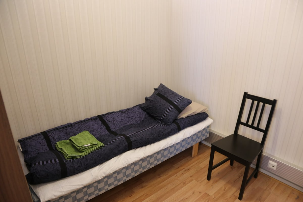 There is kind of 2nd bedroom with 1-2 beds at corner of living room, behind of closets