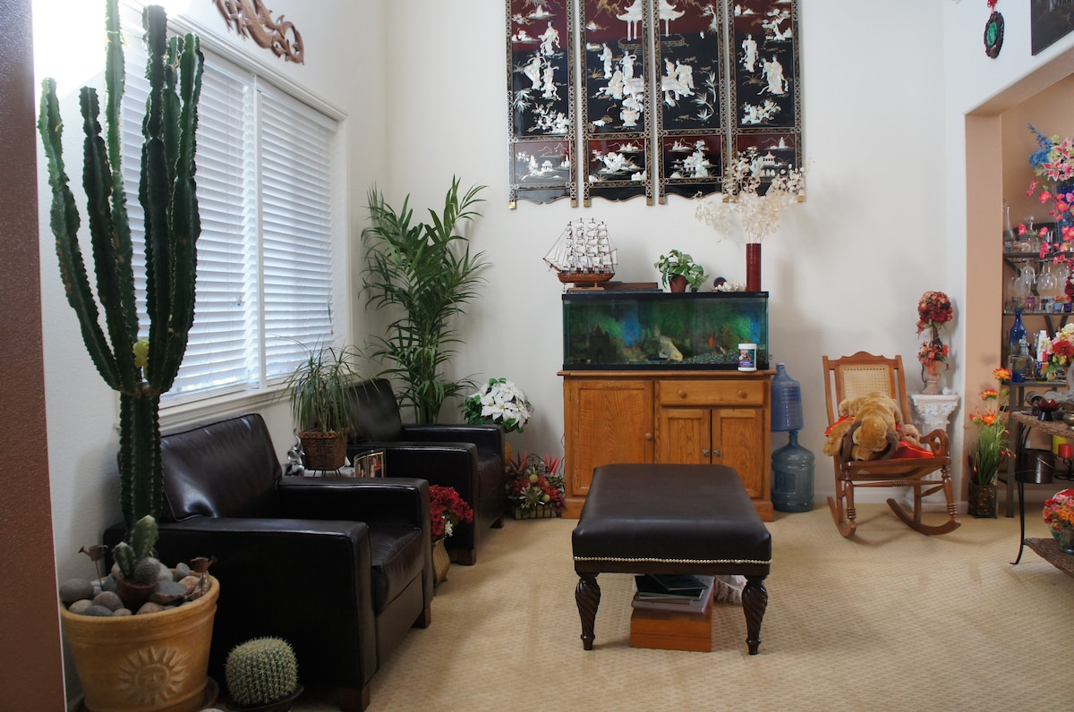 Sitting room as you enter the house, with Koi fish tank.