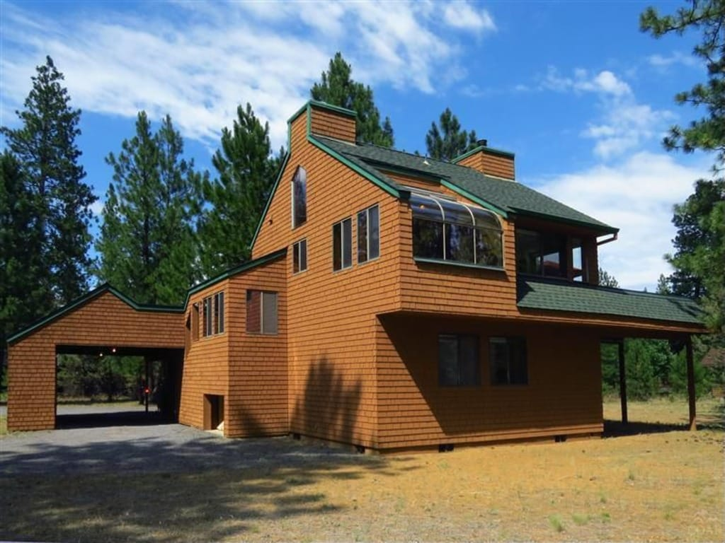 Unique custom built cabin with attached covered carport!
