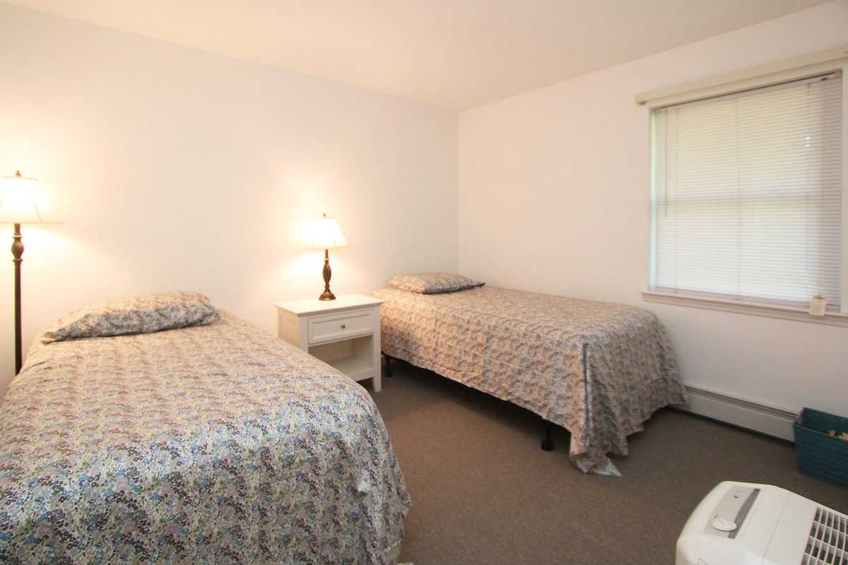 With twin beds, the third bedroom sleeps two.