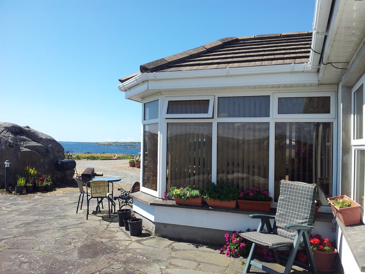 Small conservatory/leading to kitchen /2 bedrooms.Located in Kilkieran.Connemara. Not in Galway City.