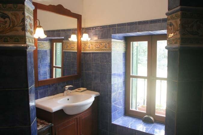 An Italian open shower with handmade tiles.