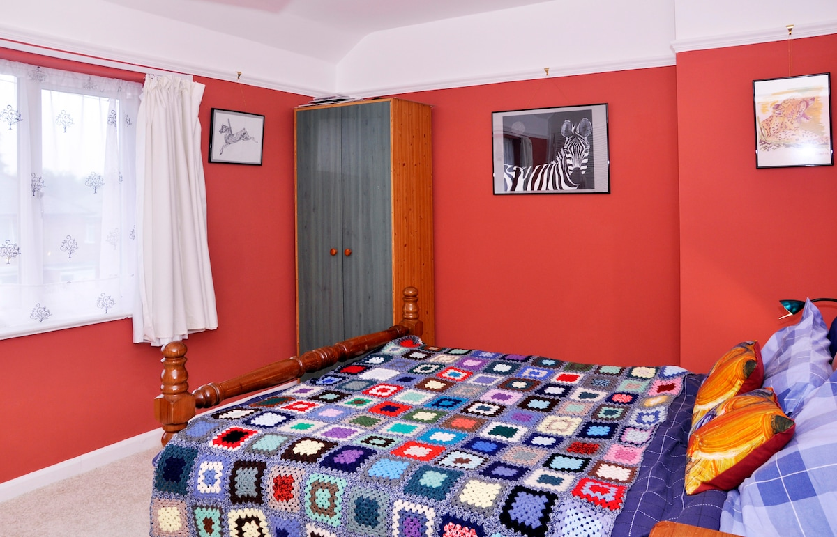 You will sleep in the large double bedroom at the front of the house.