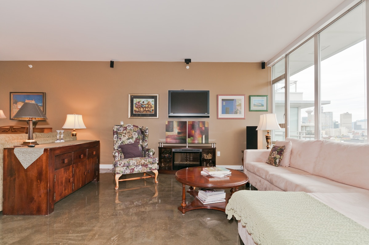 Living area features generous seating to lounge. view TV, or cozy up to electric fireplace.